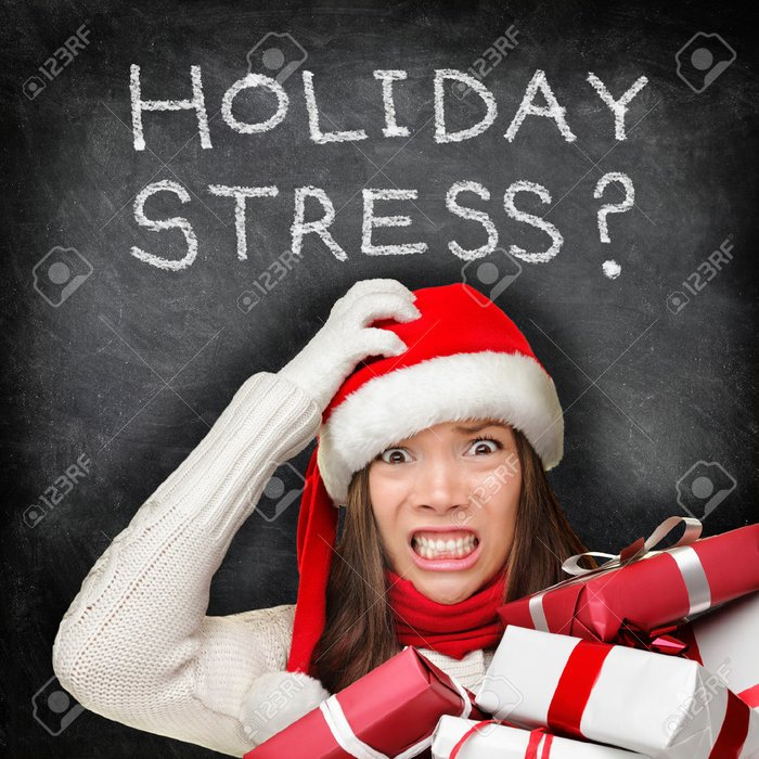 23088163-Christmas-holiday-stress-Stressed-woman-shopping-for-gifts-holding-christmas-presents-wearing-red-sa-Stock-Photo